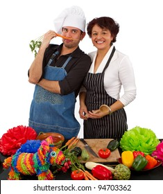 Two Mexican chefs preparing a meal for a Cinco de Mayo fiesta