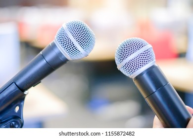 two microphones with blur background at traning classroon.concept communication talking image.