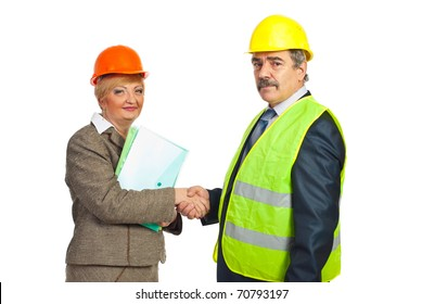 two middle aged architects shaking hands  for an agreement isolated on white background