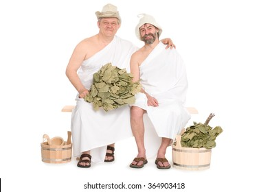 Two middle-aged men in traditional Russian sauna bathing costumes. From a series of Russian bath