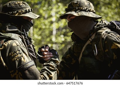 Two military men shaking hands