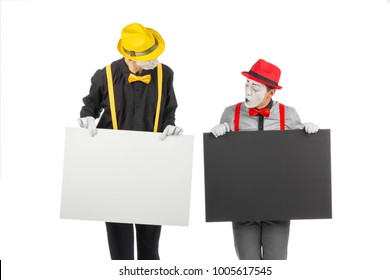 Two mimes with a large empty board. Isolated on white background.