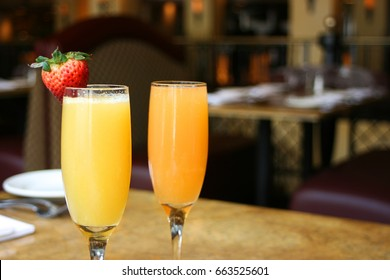 Two mimosa cocktail glasses, horizontal
