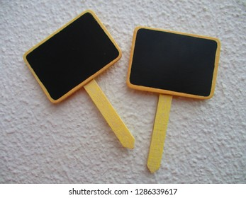 Two mini chalkboards on sticks isolated on a white background