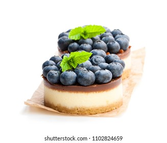 Two mini  chocolate cheesecake with fresh blueberry isolated on white