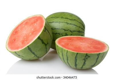 Two mini watermelons with one sliced in half