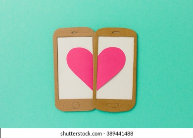 Two mobile phone screens combining a pink heart - paper illustration image concept for online dating, flirting, chatting with space available for copy text