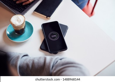 Two Mobiles Phone To Phone Wirelessly Charging On Desk