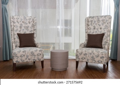 Two modeern chairs in livingroom.