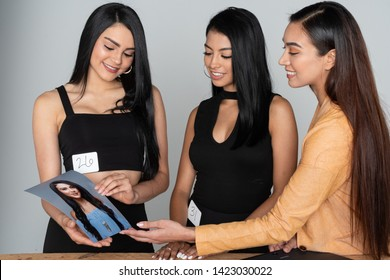 Two models meeting with a casting director at a modeling agency