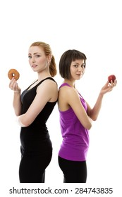 two models wearing gym clothes standing back to back one is holding a doughnut and the other is holding an apple