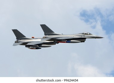Two modern fighter jets at high altitude