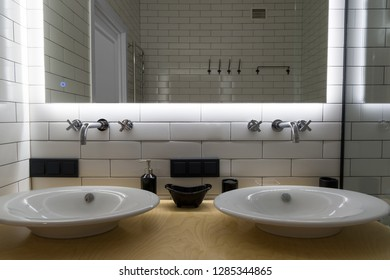 Two modern sink in the bathroom, and big mirror