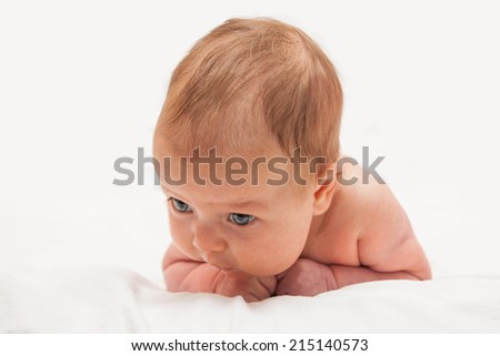 Two Month Old Baby Laying On His Tummy And Trying To Hold His Head Baby