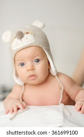 Two months old newborn baby in funny hat