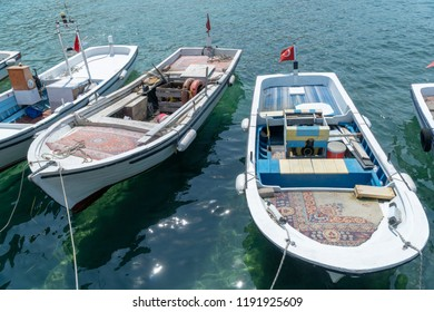 Two moored wooden traditional fishing boats. These boat are using fishing and also short distance transportation. Interesting thing is old carpets are used these boat's decks for decoration.