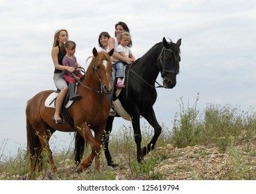 two mother and their children with their horses