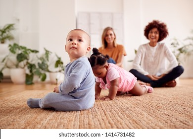 Two Mothers Meeting For Play Date With Babies At Home In Loft Apartment