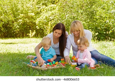 two mothers playing with children. Early child development