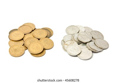 "Two mounds of old spanish coins (""pesetas"", pre-euro)."