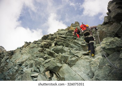 Two mountaineers on the ridge climbing Grossglockner, Austria
