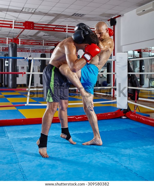 Two muay thai fighters in a sparring match in the ring