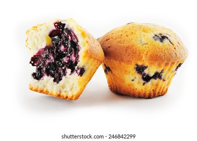 Two muffins with blueberry on white background