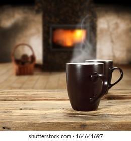 two mugs and fireplace