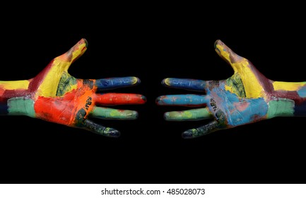 Two Multi Color painted hands coming to each other