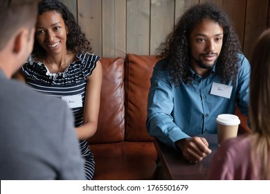 Two multi ethnic couples African and Caucasian potential partner, love seeker, participating in speed dating meeting, romantic activity interact in cafe. First impression, flirtation, sympathy concept