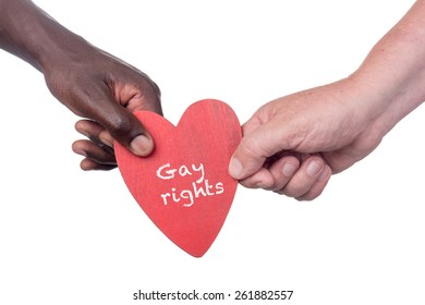 Two multi racial men holding a gay rights wooden heart