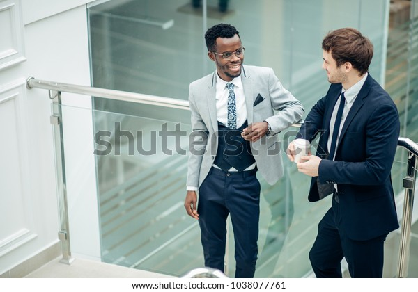 two multiethnic happy Business partners talking inside the building under construction