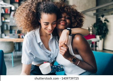 two multiracial friends posing together and sharing happiness – communication, cheerful, relationship