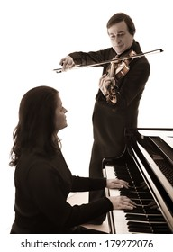 Two musicians play the grand piano and viola