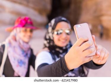 Two Muslim Arabic girls taking a selfie during travel