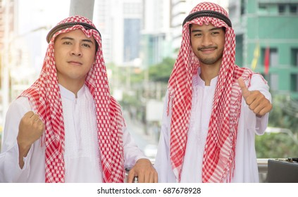 Two Muslim businessmen are discussing a joint business.