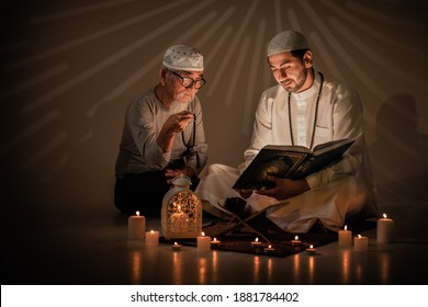 two muslim people read and study islam holy al quran book together during ramadan period. Al quran book with written arabic calligraphy meaning of Al Quran