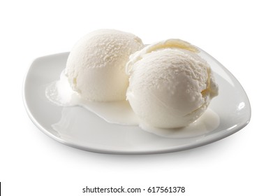 Two natural melted ice cream balls close-up isolated on white background