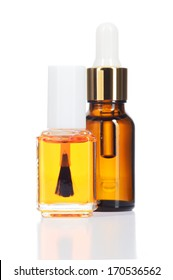 Two natural oils for beauty care isolated on white background. Nail and cuticle oil and body oil in glass bottle.