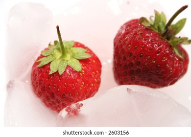 Two natural strawberrys on the ice.