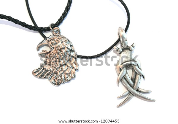 Two necklaces with cool medalions on the white.