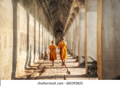 Two neophytes walking in an Angkor Wat, Siem Reap, Cambodia.