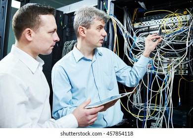 two network support engineers administrating in server room