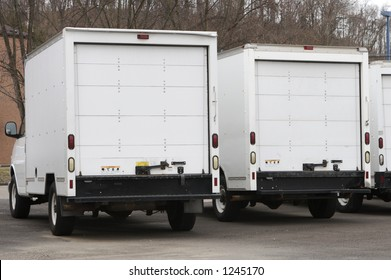 Two New Box Delivery or Moving Trucks