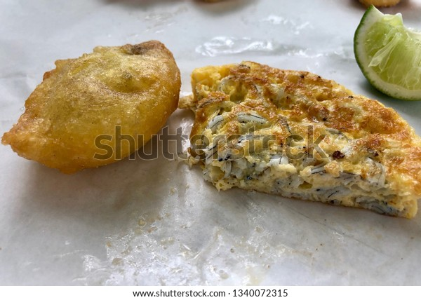 Two New Zealand culinary delights; a Bluff oyster and a whitebait fritter.