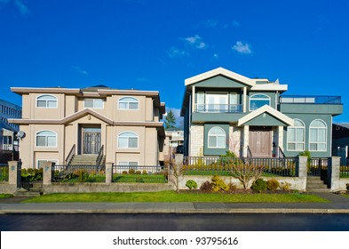 Two nice looking houses with blue sky as a background  in a sunny  day.