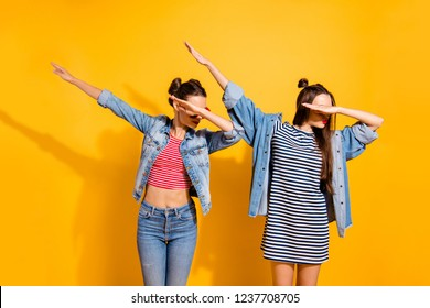 Two nice-looking good-dressed cute sweet gorgeous brunette hair lady stand isolated on yellow wall make dabbing movement