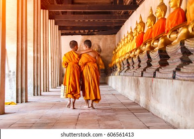 Two novices walking and talking in old temple at Ayutthaya Province, Thailand.