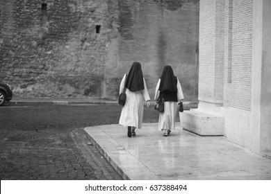 Two nuns at the Cathedral of St. Peter in the Vatican. Rome, Italy.