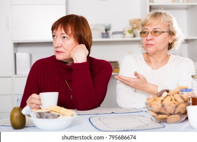 Two offended elderly women squabbling at home